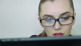 Close-up. Girl works with the tablet. Woman using tablet computer. Business office stock video footage