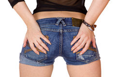 Close up a of girls back in blue shorts isolated. Hands nails Royalty Free Stock Photos