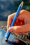 Close up of girls hand with notebook, pen and mobile phone Royalty Free Stock Photo