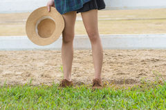 Close up of a girls legs front of the white fence Royalty Free Stock Image