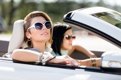 Close up of girls in sunglasses in the cabriolet Royalty Free Stock Photos