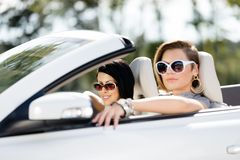 Close up of girls in sunglasses in the car Stock Photo