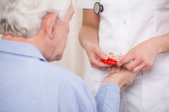 Close-up of giving medicine stock images