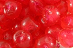 Close-Up of Glace Cherries. A close up of intact glace cherries, a form of candied fruit used in cooking and decorating drinks, and perhaps also suitable as a Stock Image