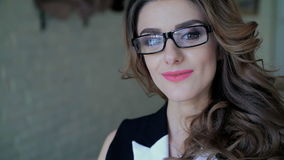 Close up of glamour lady in glasses speaking on the phone and smiling in cafe stock video footage