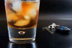 Close up glass with alcohol and auto key Stock Photo