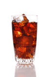 Close up of a glass of cola and Ice. Cubes with condensation. Vertical format with reflection isolated on white Royalty Free Stock Images