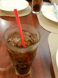 Close-up glass of cola with ice cubes and straw Royalty Free Stock Images