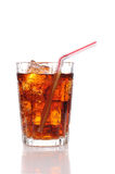 Close up of a glass of cola and Ice with straw Royalty Free Stock Photography