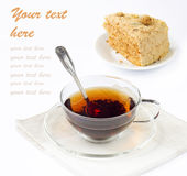 Close-up of glass  cup of tea and tasty cake Stock Photography