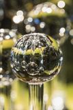 Close up of glass globe reflecting other globes royalty free stock image