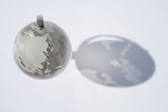 Close up of glass globe with shadow Royalty Free Stock Photos