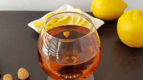 Close up of a glass half full with brandy stock image