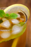 Close-up of glass iced tea with lemon and mint, selective focus Stock Images