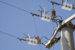 Close-up of glass insulators. Electric transmission pylons. Close-up of glass insulators Royalty Free Stock Photos