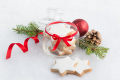 Close up of a glass jar full with christmas homemade star cookies over white fluffy background. Christmas decoration. Stock Photography