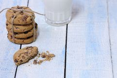 Close-up of glass of milk and stack of cookies Stock Images