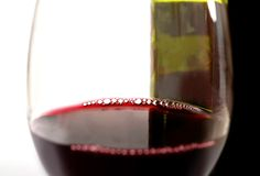 Close Up Glass of Red and Bottle Royalty Free Stock Photo