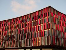 Close Up of Glass and Red Metal Facade of Air Albania Stadium