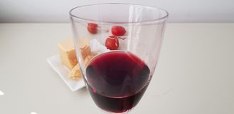 Close up of glass of red vine with liquid drops stock images