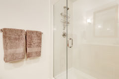 Close up of glass shower cabin in white clean bathroom royalty free stock image