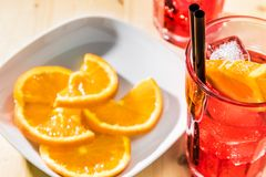 Close-up of glass of spritz aperitif aperol cocktail with orange slices and ice cubes Royalty Free Stock Photography