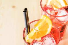 Close-up of glass of spritz aperitif aperol cocktail with orange slices and ice cubes Stock Photo