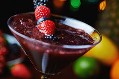 Close up glass of tropical cocktail with berries or lemonade. Royalty Free Stock Photos