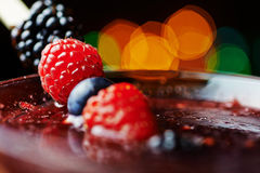 Close up glass of tropical cocktail with berries or lemonade. Royalty Free Stock Photography