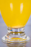 Close up of a glass of vitamin C dissolved over the table Stock Photography
