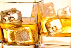 Close-up of a glass of whiskey with ice Royalty Free Stock Images