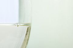 Close up of glass with white wine Stock Image