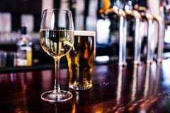 Close up of a glass of wine and a beer. In a bar royalty free stock photo