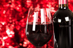 Close up on Glass of Wine with Lights Background. Royalty Free Stock Image