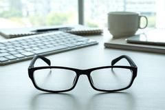 Close up of glasses and computer business workplace work place Royalty Free Stock Photos