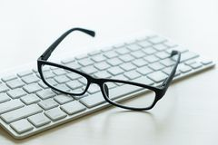 Close up of glasses and computer  business workplace work place Royalty Free Stock Image