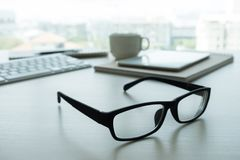 Close up of glasses and computer  business workplace work place Royalty Free Stock Images