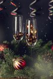 Close Up Glasses with Decoration and Champagne Bottle Wooden Background Christmas New Year Holidays Card New Year Background Verti. Cal Toned Fir royalty free stock image
