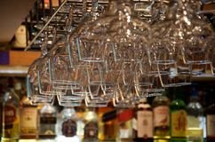 Close-up of glasses fixed upside down in the bar royalty free stock photo