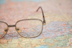 Close-up of glasses on map stock photos