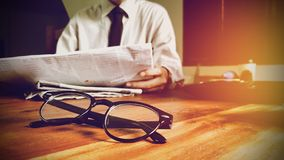 Free Close Up Glasses. Newsletter Concept Businessman Reading News The Newspaper On Desk In Office Stock Images - 158828534