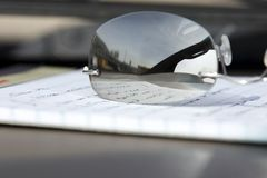 Close up on the Glasses and the Notepad Stock Photo