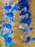 Close up glasses souvenir figurines of elephants and dolphins in royalty free stock photos