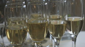 Close-up of glasses of sparkling wine on table stock footage