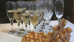 Close-up of glasses of sparkling wine on table stock video footage
