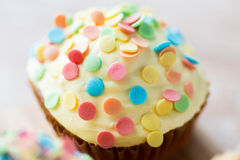 Close up of glazed cupcake or muffin on table Royalty Free Stock Photos