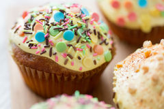 Close up of glazed cupcakes or muffins on table Stock Photo