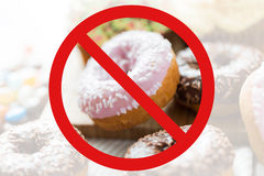 Close up of glazed donuts pile behind no symbol Stock Image