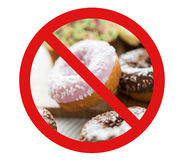 Close up of glazed donuts pile behind no symbol Royalty Free Stock Photography