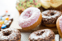Close up of glazed donuts pile on table Royalty Free Stock Photo